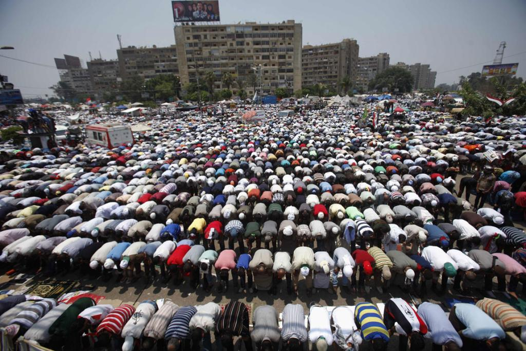 Supporters of Egyptian President Mohamed Mursi perform prayers during a protest to show support.