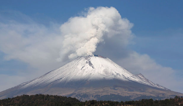SPEWING ASH: The snow-covered Popocatepetl volcano spews a cloud of steam high into the air in Puebla.