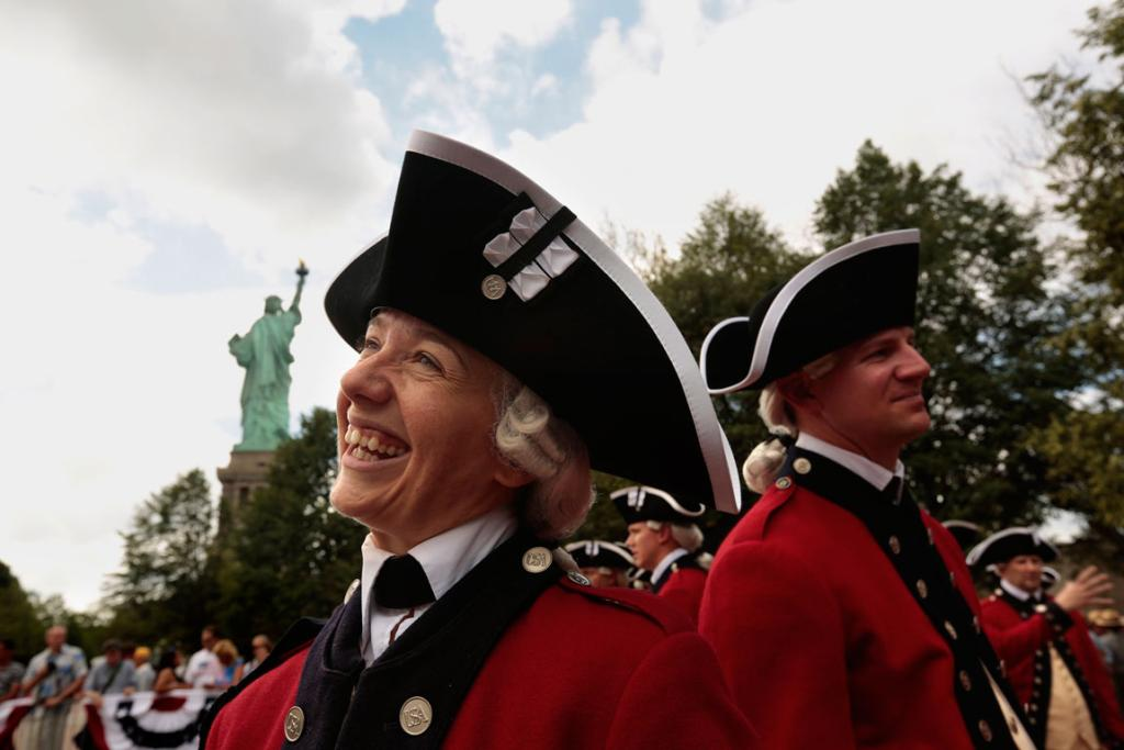 Members of the US Army Old Guard Fife and Drum Corps of Washington, DC, perform during the reopening ceremony.