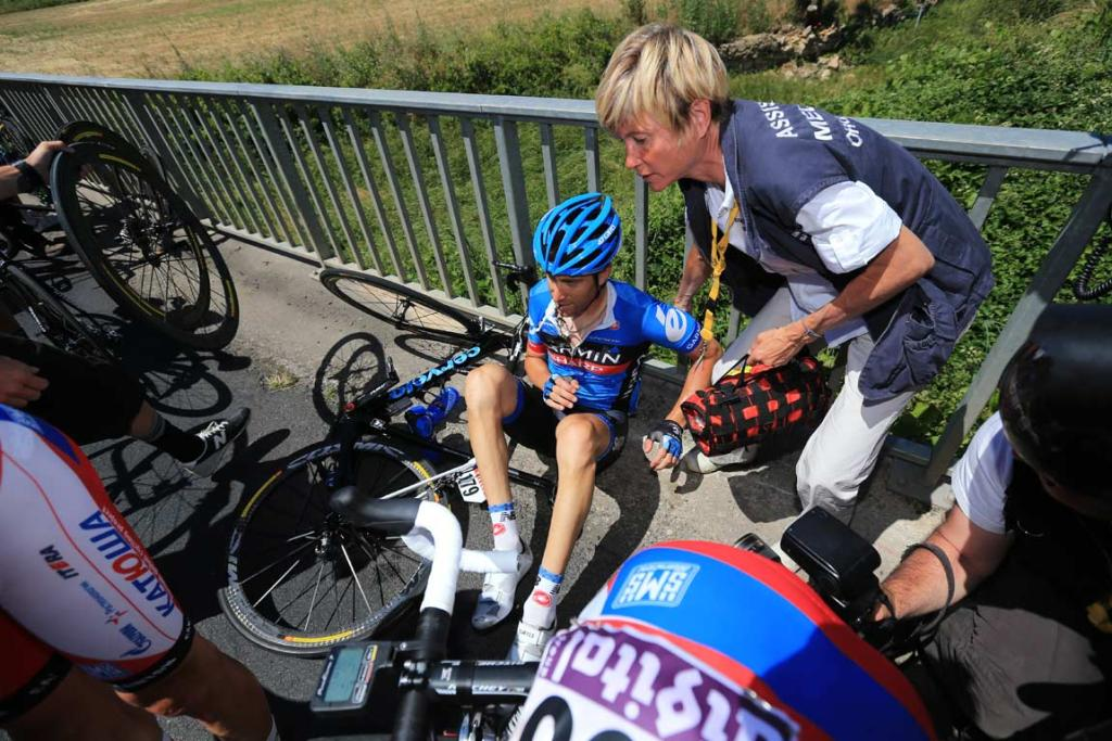 Christian Vande Velde is treated after a crash during the seventh stage from Montpellier.