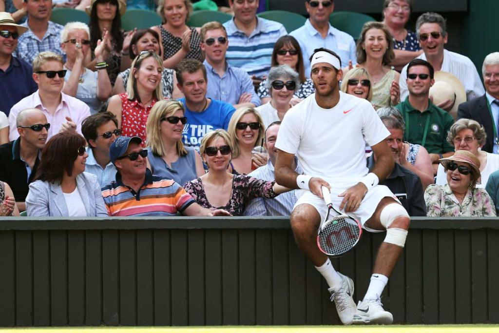 Juan Martin del Potro takes a seat with the crowd to catch his breath.