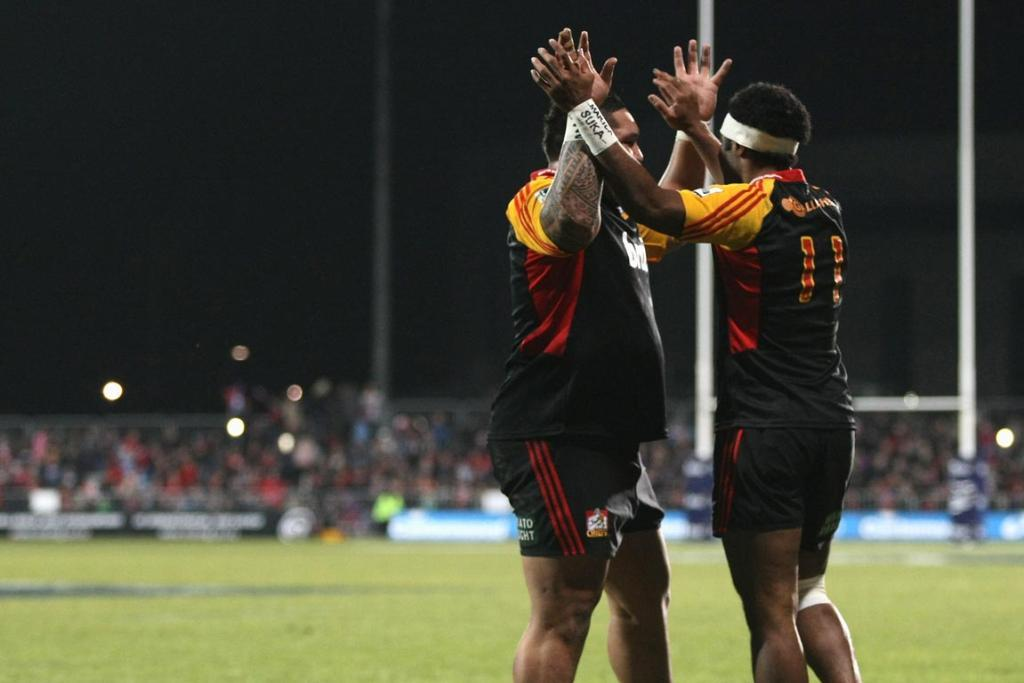 Aseli Tikoirotuma of the Chiefs celebrates his try with Ben Tameifuna during the round 19 Super Rugby match between the Crusaders and the Chiefs.