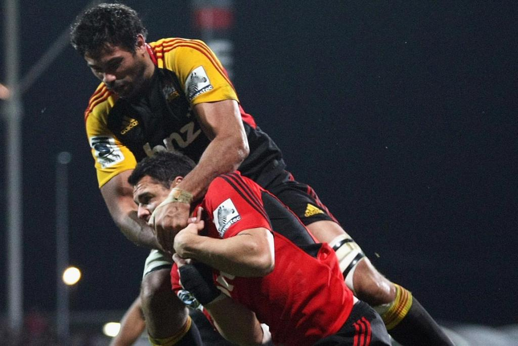 Ross Filipo of the Chiefs tackles Dan Carter of the Crusaders after a kick in the Crusaders in goal during the round 19 Super Rugby match between the Crusaders and the Chiefs.