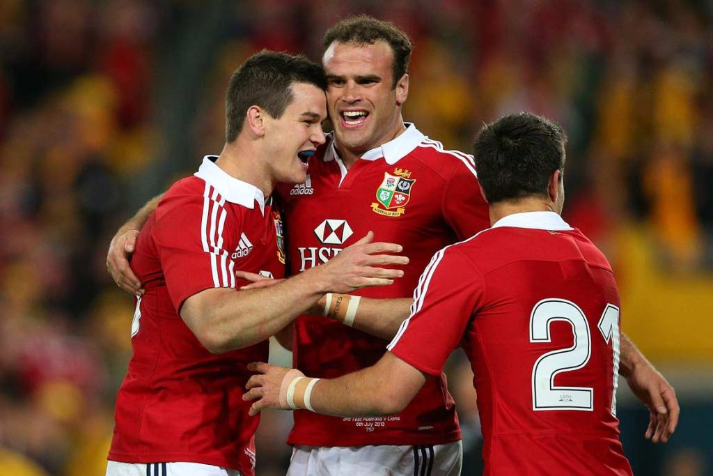 Jamie Roberts (centre) and Conor Murray congratulate Jonathan Sexton on his second half try.