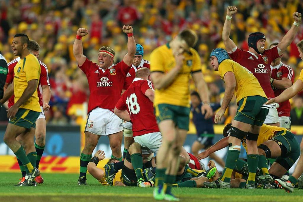 Lions and Wallabies players show contrasting emotions at the final whistle.
