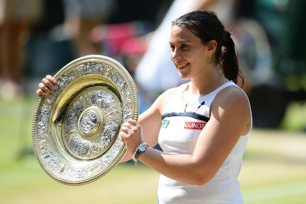 Marion Bartoli with the Venus Rosewater Dish after winning the ladies singles final at Wimbledon.