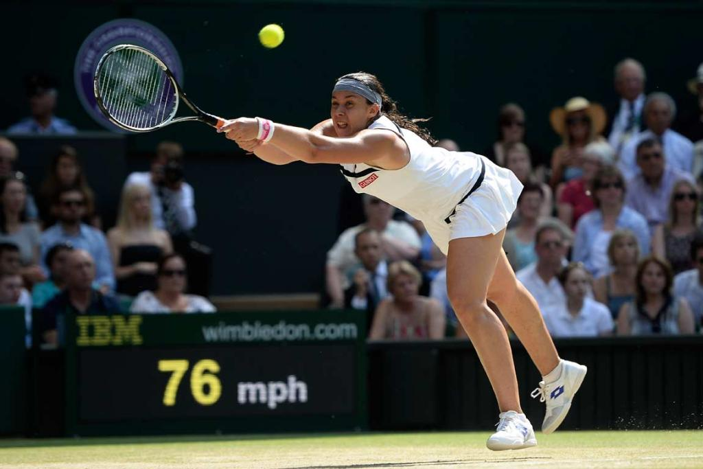 Marion Bartoli is at full-stretch to play a shot.