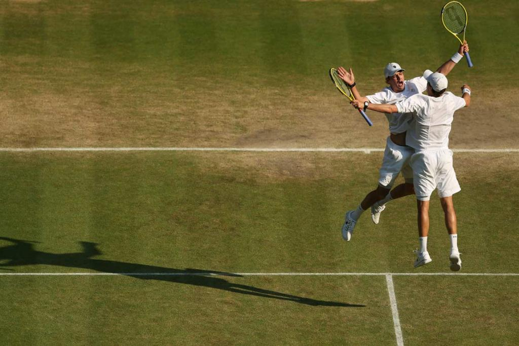 The Bryan brothers do their trademark chest-bump after winning the Wimbledon title.