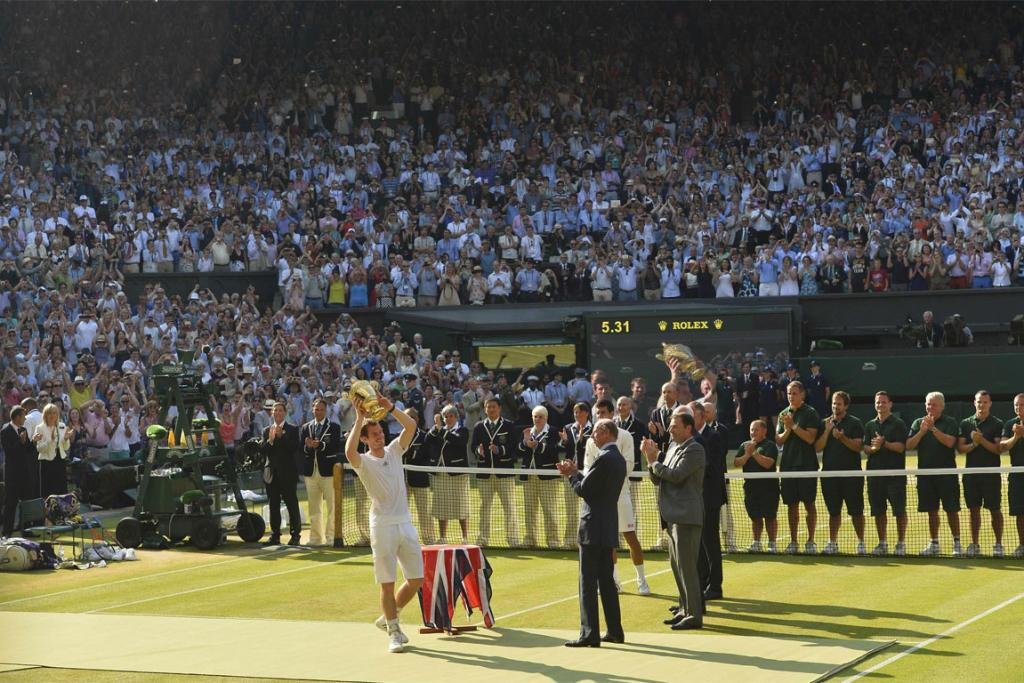 Andy Murray lifts the Wimbledon trophy.