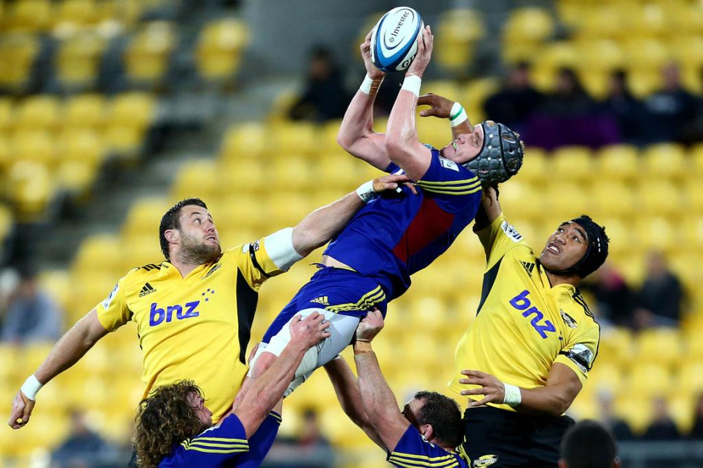 Josh Bekhuis of the Highlanders goes for the high ball during their game against the Hurricanes.