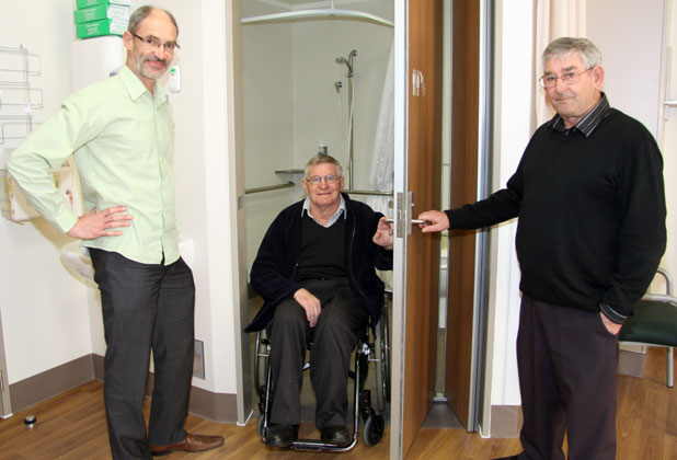 Brand new: Taking a look at the special folding doors on bathroom suites are, from left base hospital redevelopment project manager Steve Berendsen with John Major and Brian Eriksen from the Taranaki District Health Board Disability Action Group.