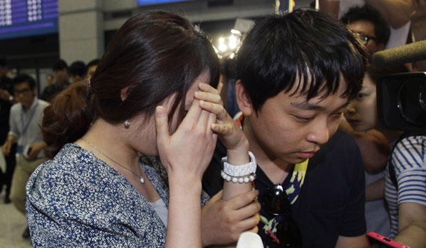 TRAUMATIC TIME: Passengers who were involved in the San Fransisco plane crash arrive at Incheon International Airport in South Korea.
