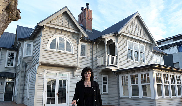 RESTORED TO GLORY: Jacqui Lee, owner of Ironside House, proudly shows that restoration on the heritage building is complete.