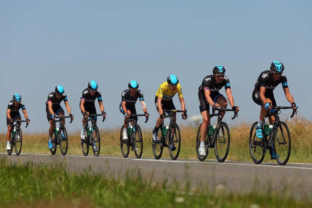 Team Sky riders, including yellow jersey holder Chris Froome, lead the peloton.