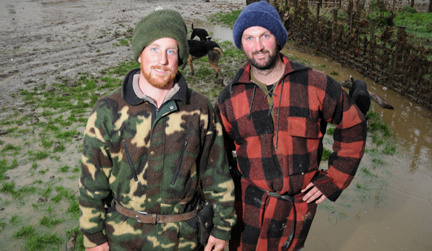 IN DEEP: Farm worker Sam Moore and Darren Walton, stock manager for Manawa Station, were caught by a flash flood which swept their vehicles away. The Whareama River overflowed its banks north of Tinui and flooded farmland, catching four men by surprise.