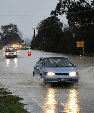 UP TO THE AXLES: Flooding on the Masterton-Castlepoint Road.