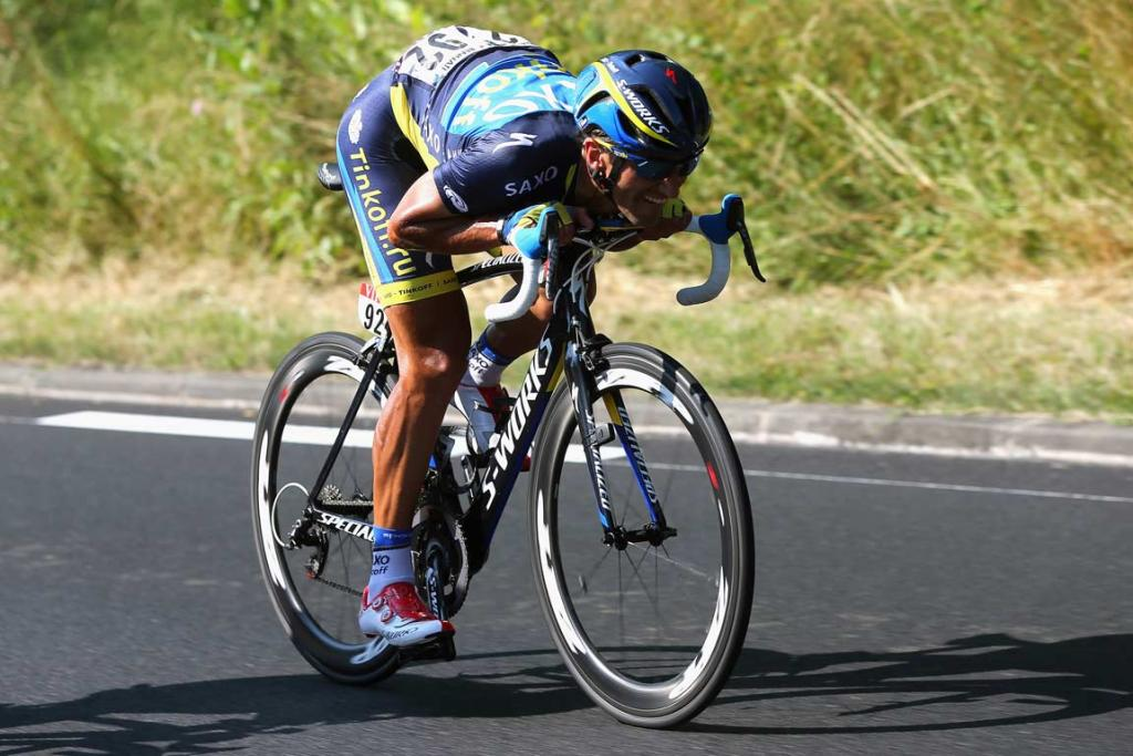 Daniele Bennati of Team Saxo-Tinkoff gets in aerodynamic position during a descent on stage 13.