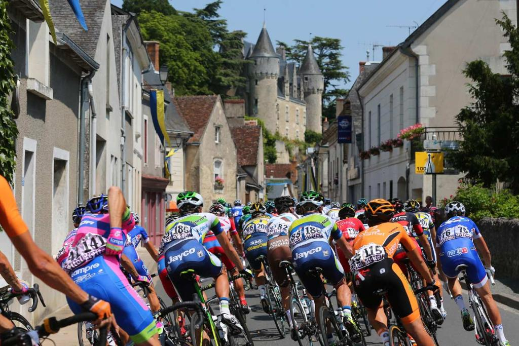 The Tour de France peloton head through a village during the 13th stage.