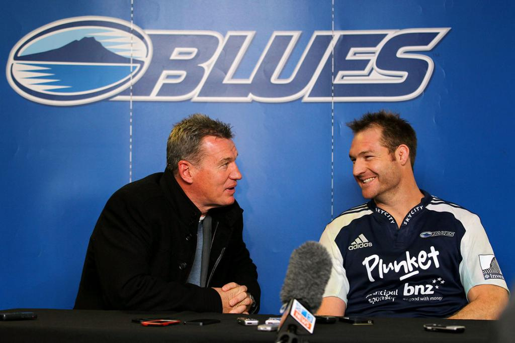Departing Ali Williams shares a laugh with coach Sir John Kirwan after his last game for the Blues.