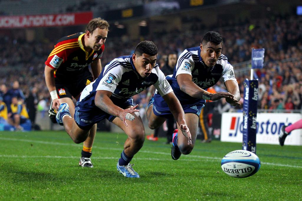 Charles Piutau chases the ball down to score for the Blues.