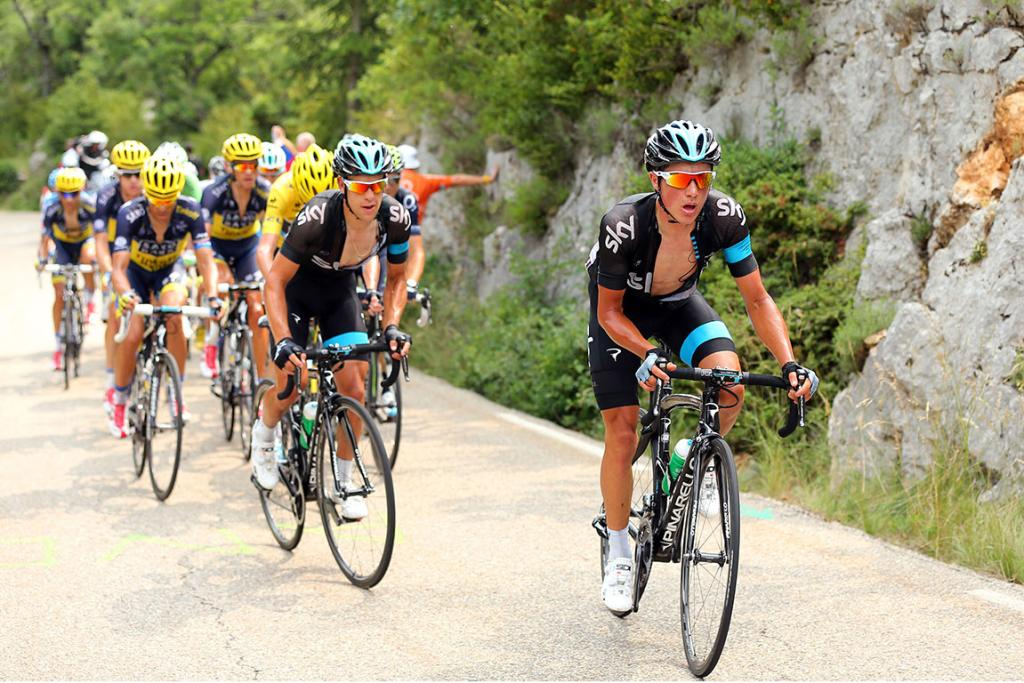 Peter Kennaugh of Great Britain and SKY Procycling rides at the front of the peloton during stage 15.