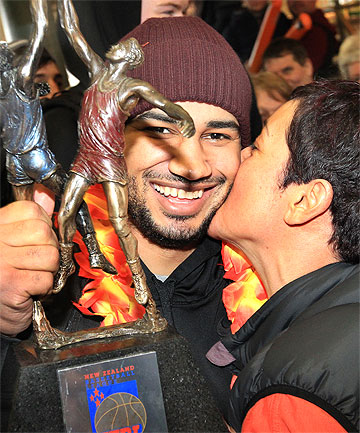 MWAH! Kevin Braswell receives a congatulations kiss from Sharks Fan Lisa Tou-McNaught.