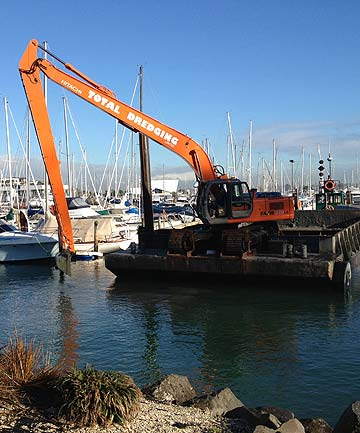 NECESSARY HOUSEKEEPING: Material dredged out of Half Moon Bay Marina might have been disposed of locally had Auckland Council been faster with its ferry terminal development.