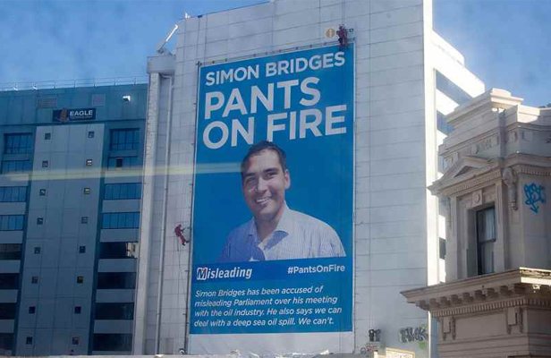 IN YOUR FACE: Greenpeace has put up a giant billboard attacking Energy Minister Simon Bridges.