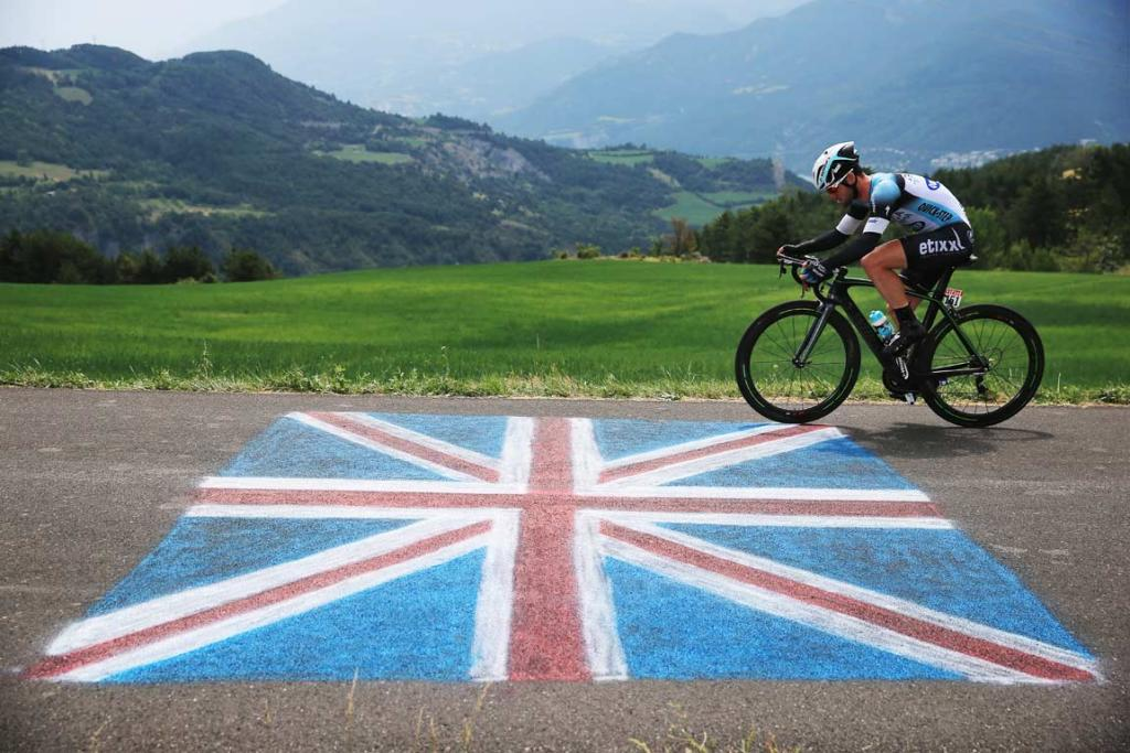 Briton Mark Cavendish rides over a Union Jack painted on the road.