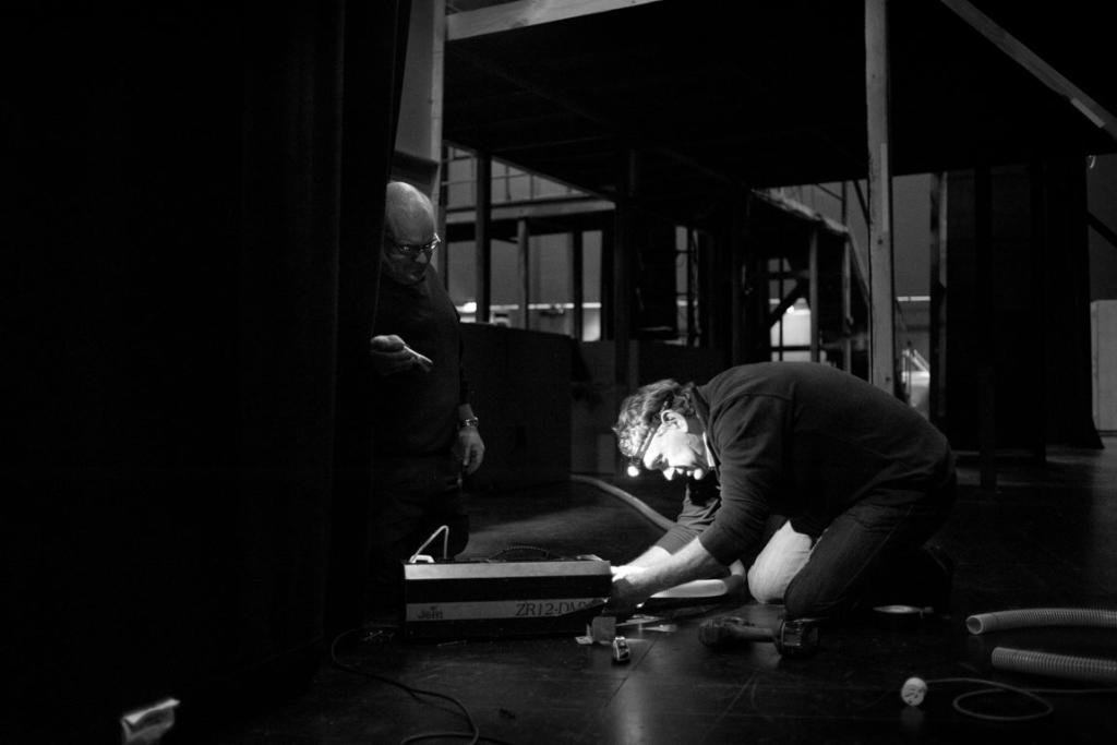 Theatre technician Jeff Ross (left) and technical manager Neale Smith make some quick adjustments to equipment before the curtain goes up.