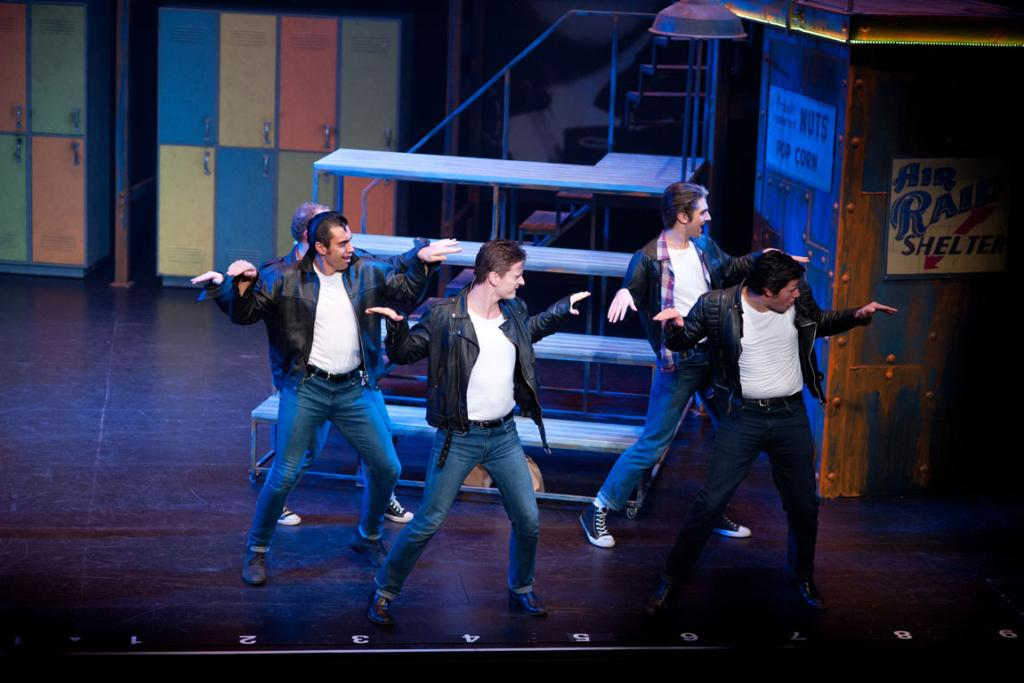 T-Birds in Invercargill Musical Theatre's production of Grease, from left, Daniel Neas as Roger (obscured), Waaka Parkinson as Sonny, Steve Broad as Danny, Daniel Monteath as Doody, and James Stephenson as Kenickie.