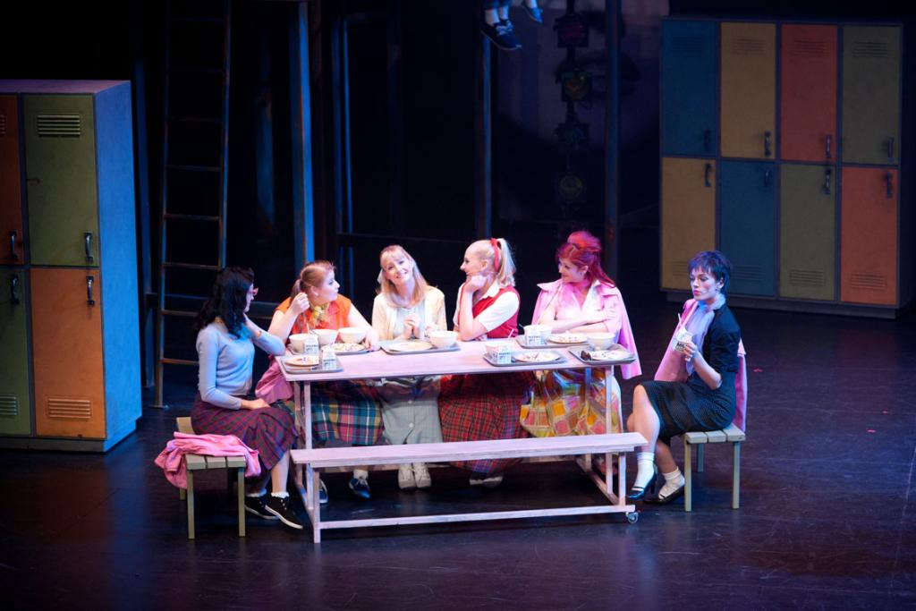 The pink ladies and Patti, from left, Alice McKinlay as Marty, Aleisha Kennard as Jan, Amber Reed-Parkinson as Sandy, Sarah Donnelly as Patti, Kate McIlwrick as Frenchy, and Libby Fraser as Rizzo, for Invercargill Musical Theatre's production of Grease.