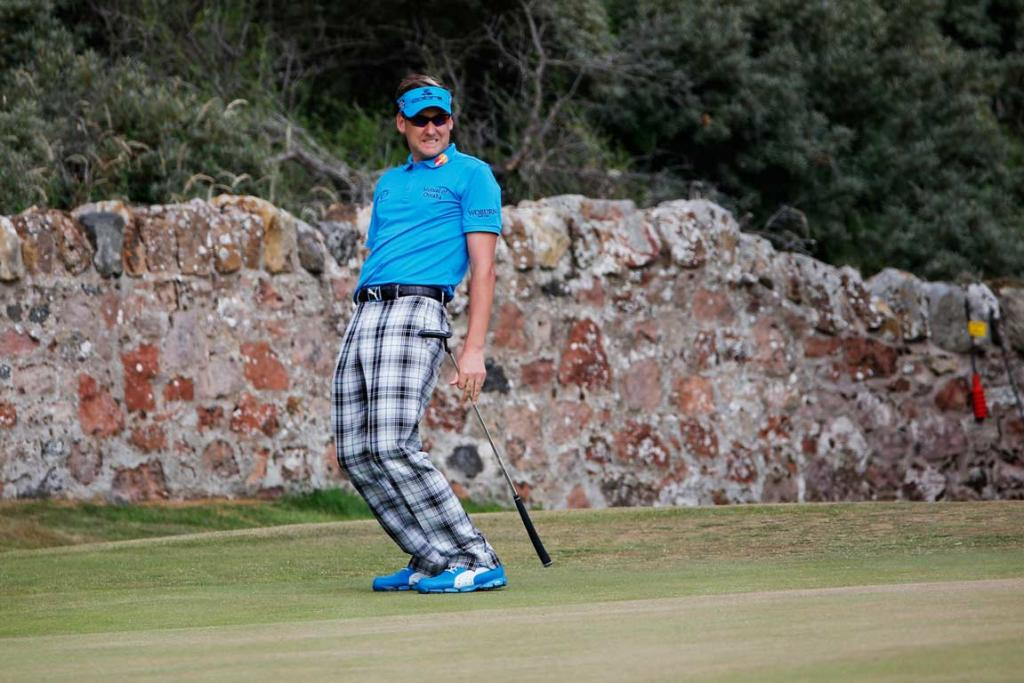 Ian Poulter tries to use body English to move a putt during his first round.