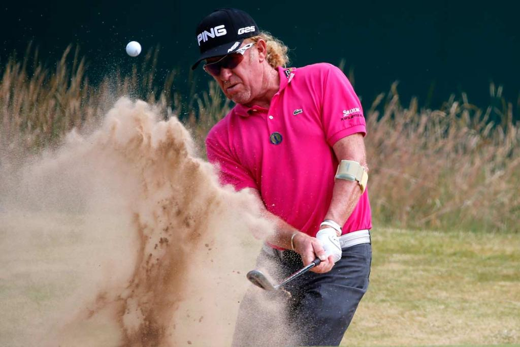 Miguel Angel Jimenez plays out of the bunker on the 18th hole.