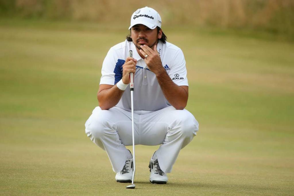 Jason Day ponders a putting line on the second hole.