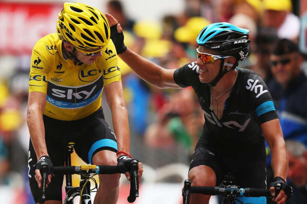 EXTENDING LEAD: Chris Froome gets a pat on the back from team-mate Richie Porte, who supported the Tour leader up the second l'Alpe d'Huez climb on Stage 18.