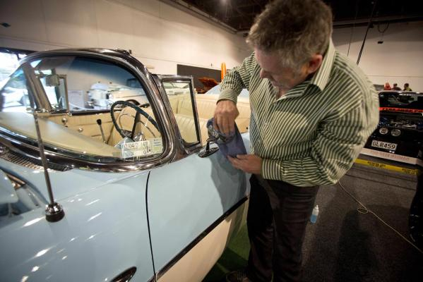Rex Moyle polishes his 1956 Buick convertible before the 2013 CRC Speedshow in Auckland.