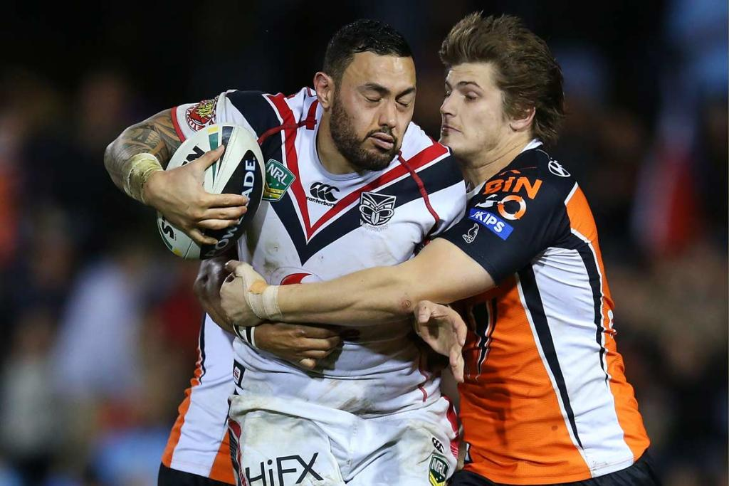 Warriors centre Feleti Mateo is tackled by Blake Ayshford.