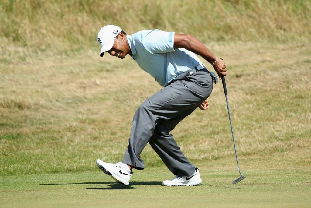 Tiger Woods reacts after missing a birdie putt on the ninth hole in the second round.
