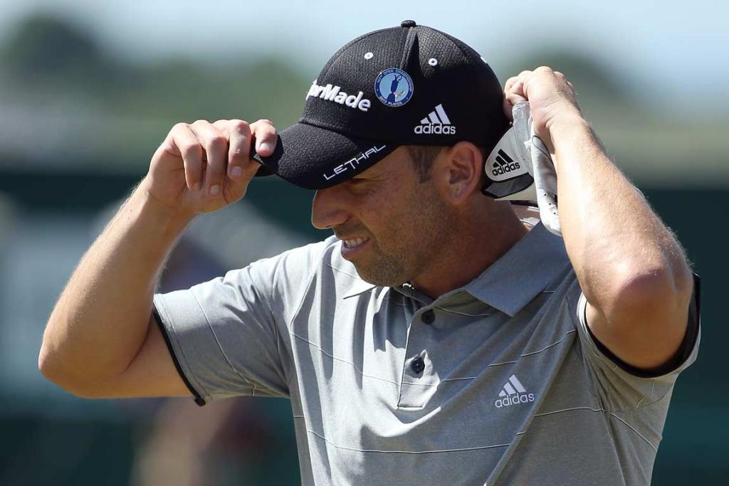 Sergio Garcia adjusts his cap after finishing his second round.
