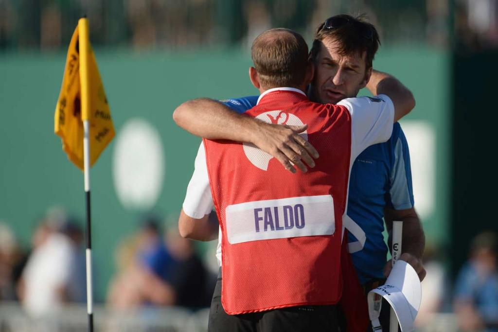 Nick Faldo hugs his caddie and son Matthew in what could be his last British Open round.