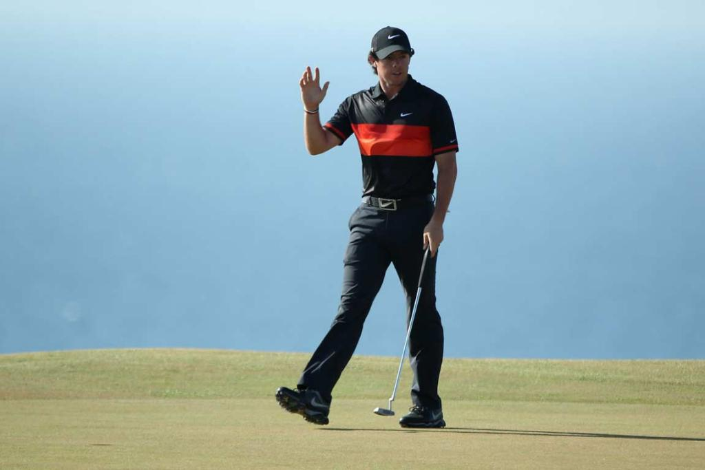 Rory McIlroy waves at the crowd after rolling in a putt in his second round.