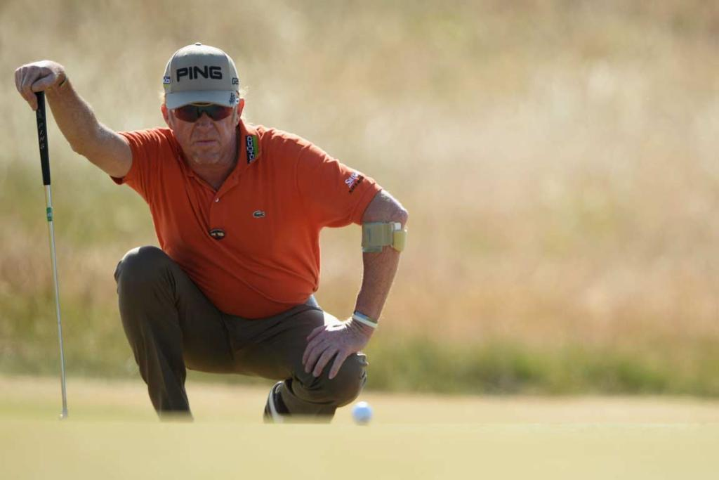 Miguel Angel Jimenez lines up a putt during his second round.