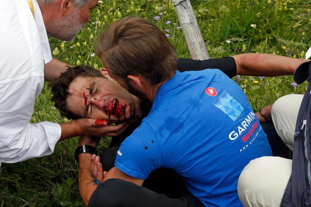 Kiwi Jack Bauer is in agony after falling from his bike into a barbed-wire fence during the 19th stage of the Tour de France.