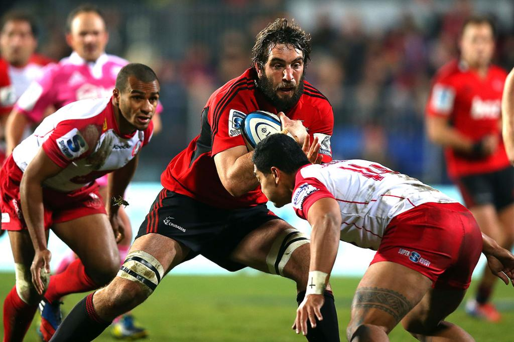 Sam Whitelock takes on the Reds defence.