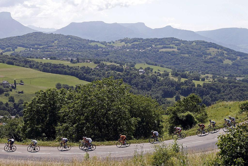 The pack of riders cycle during the 125 km stage from Annecy to Annecy-Semnoz.