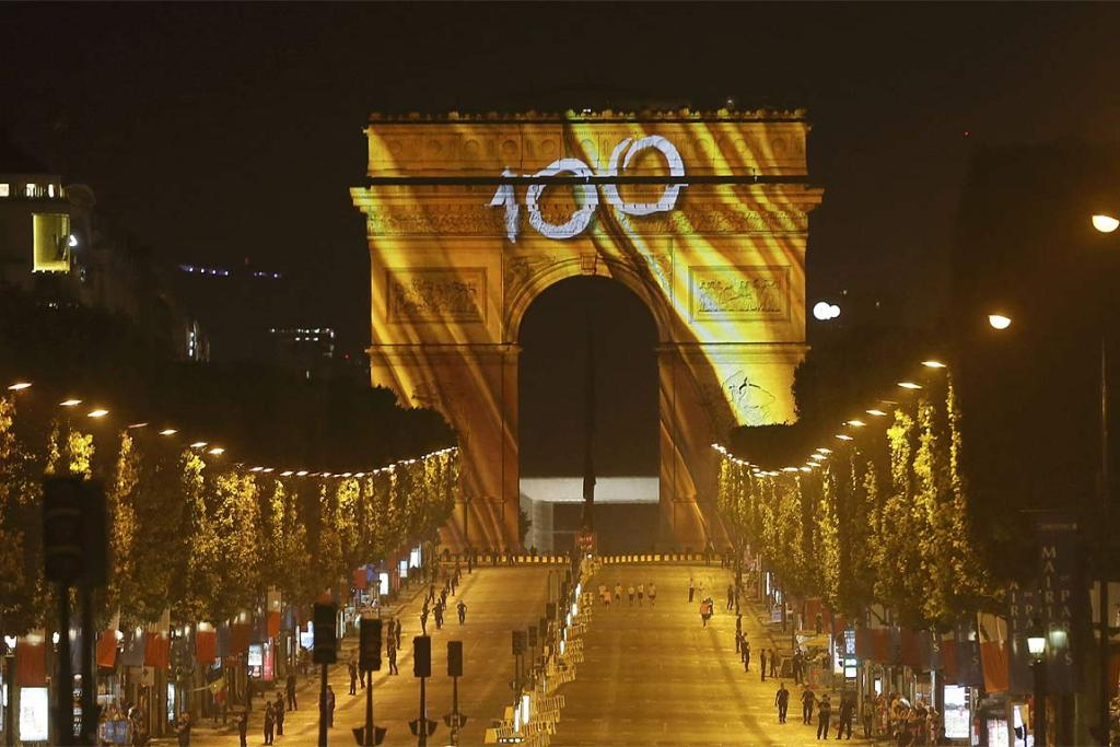 The Arc de Triomphe and the Champs Elysees Avenue are illuminated with the colour of Tour de France winner: yellow.