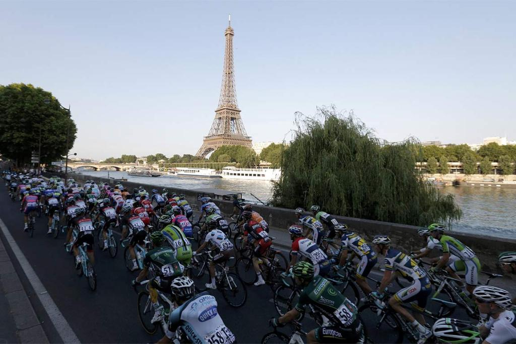 The riders cycle on the banks of the Seine river past the Eiffel Tower on the final stage of the Tour de France.