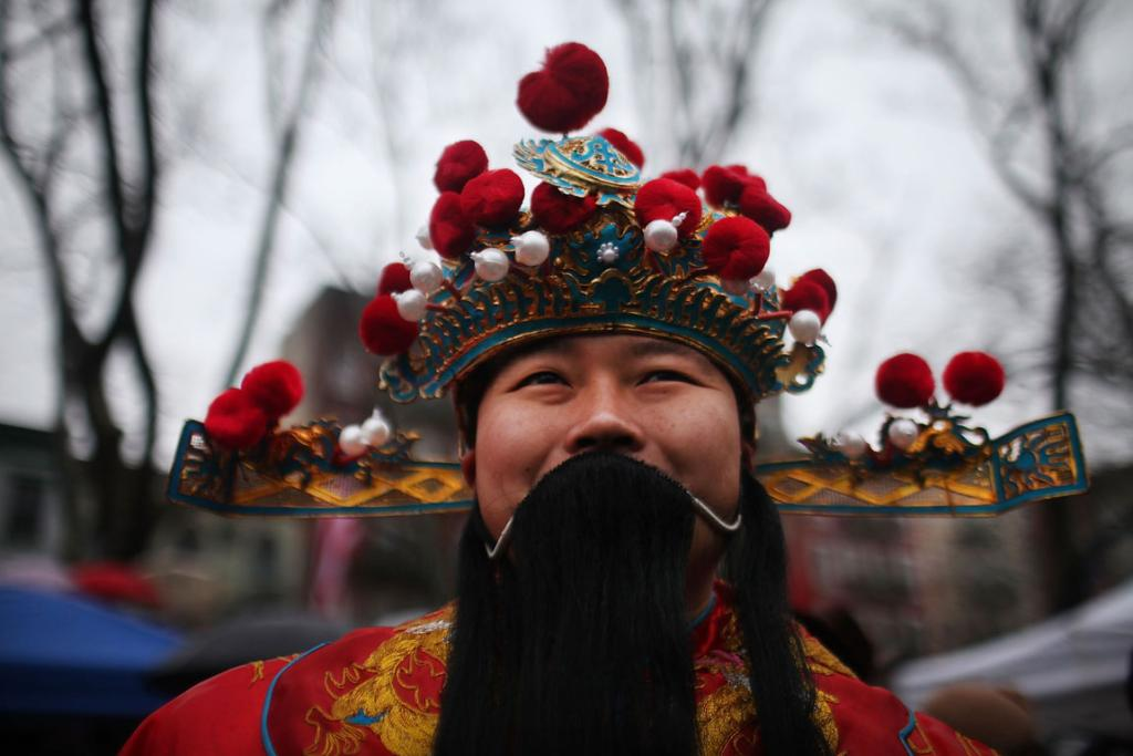 Nelson Chan is dressed as the God of Fortune in Chinatown in celebration of the Chinese New Year in New York City.
