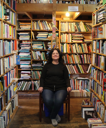 BOOK LOVER: Second-hand bookseller Shalon Ewington found her place at the Hard to Find Second Hand Bookshop in Onehunga.